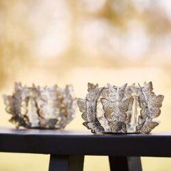 Fyrfads-lysestage-med-sommerfugle-i-metal